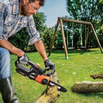 man using sharpened worx chainsaw