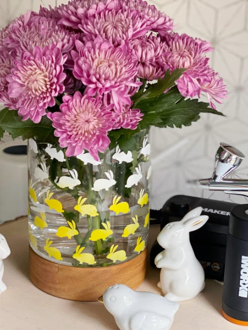 flower and vase table centerpiece airbrushed with easter bunny designs