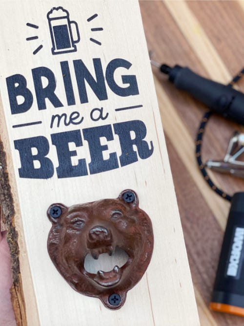 """custom made wall mount wooden bottle opener with a bear face and text that says """"bring me a beer"""""""
