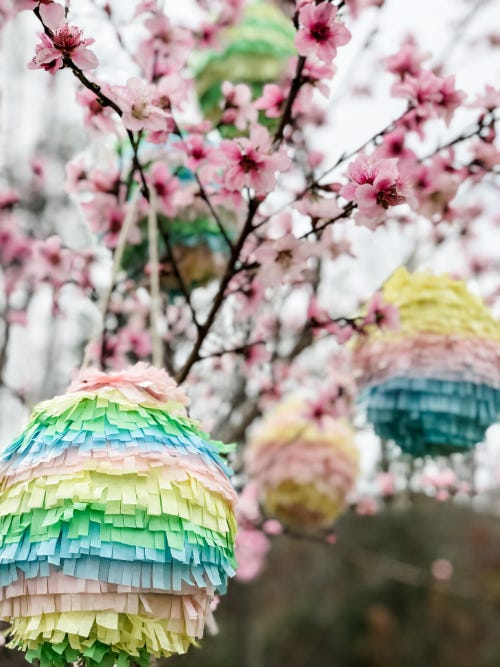 close up of a DIY easter egg pinata with pink flowers