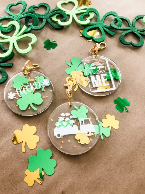 diy green and gold lucky charm keychains laying on brown table