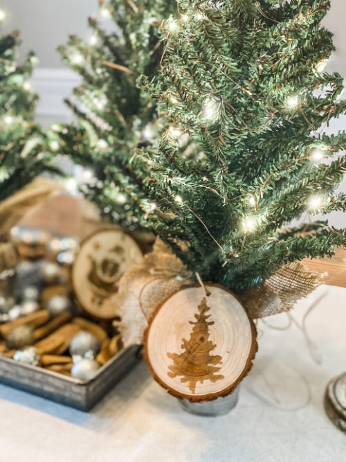 mini christmas trees with lights and wood slice ornaments