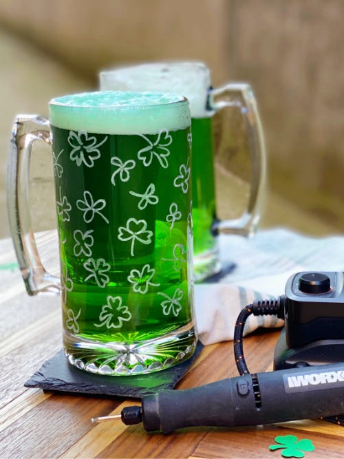 glass mug etched with shamrocks filled with green liquid