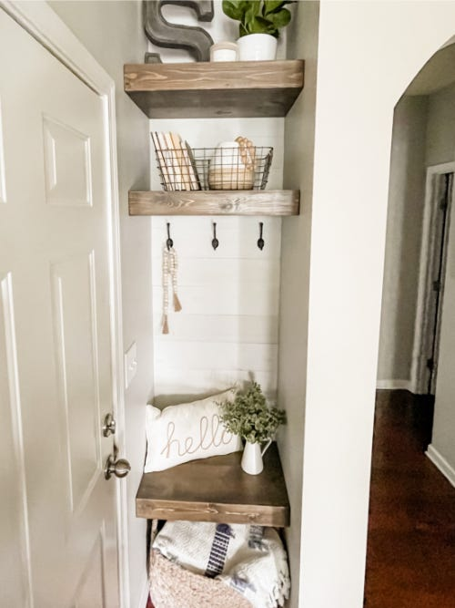 custom built wooden shelves holding basket and other items