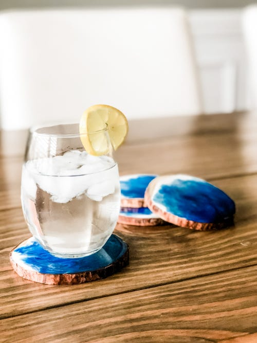 cocktail in a glass on custom made blue wooden resin coaster
